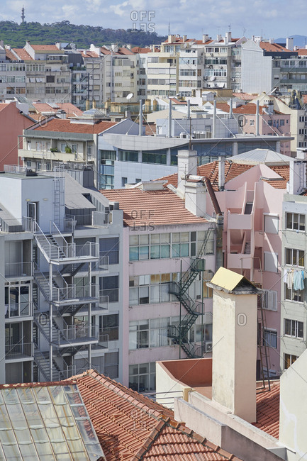 Elevated view of buildings in Lisbon, Portugal with Pena Palace in distance