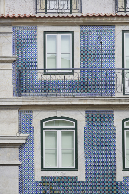 Facade of building with blue and green pattern tile in Lisbon, Portugal