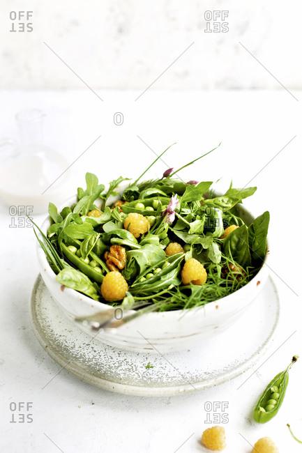 Arugula salad served in a bowl with coconut vinaigrette