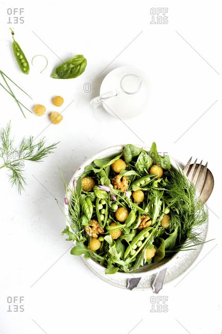 Healthy arugula salad with coconut vinaigrette