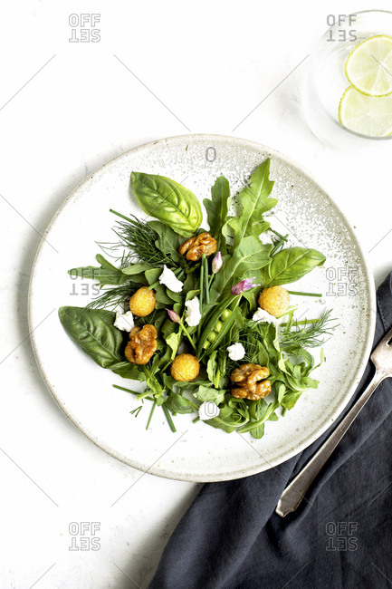 An arugula salad with coconut vinaigrette from above