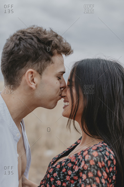 Young man kissing his lover's nose