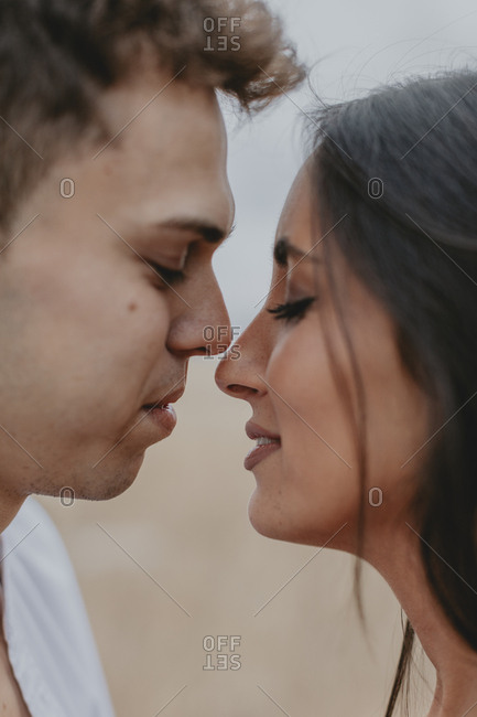 Two young people share intimate moment before kiss