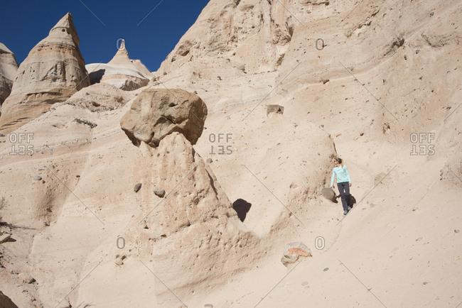 Woman hiking along a path in Kasha-Katuwe Tent Rocks National Monument, New Mexico