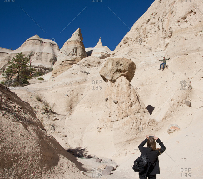 Tourist posing for a photo at Kasha-Katuwe Tent Rocks National Monument, New Mexico