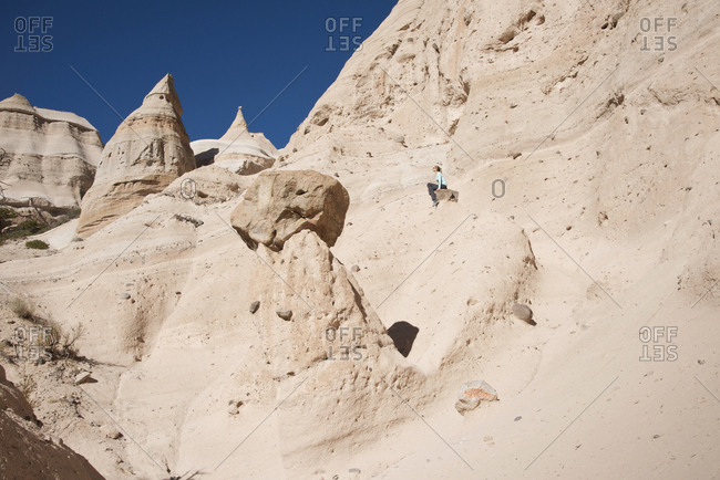 Woman relaxing along a path in Kasha-Katuwe Tent Rocks National Monument, New Mexico