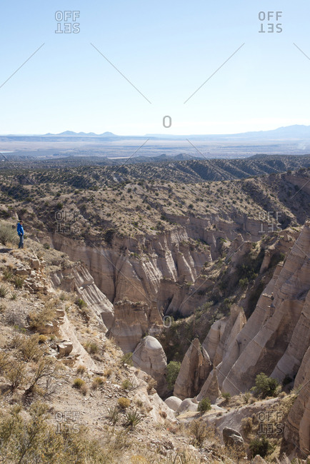 Hiker on cliff overlooking Kasha-Katuwe Tent Rocks National Monument, New Mexico