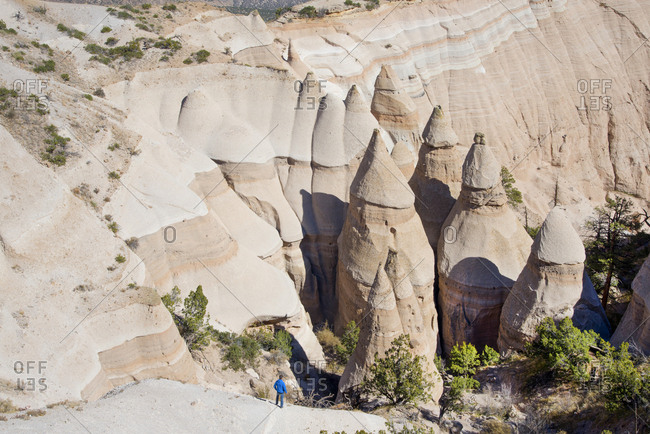 Man admiring sandstone towers in Kasha-Katuwe Tent Rocks National Monument, New Mexico