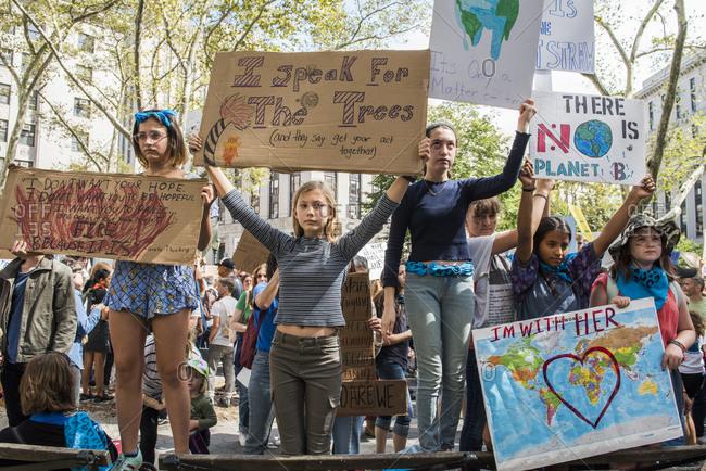 New York City, New York - September 20, 2019: Children holding signs at the Global Climate Strike