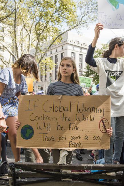 New York City, New York - September 20, 2019: Girls holding signs at the Global Climate Strike