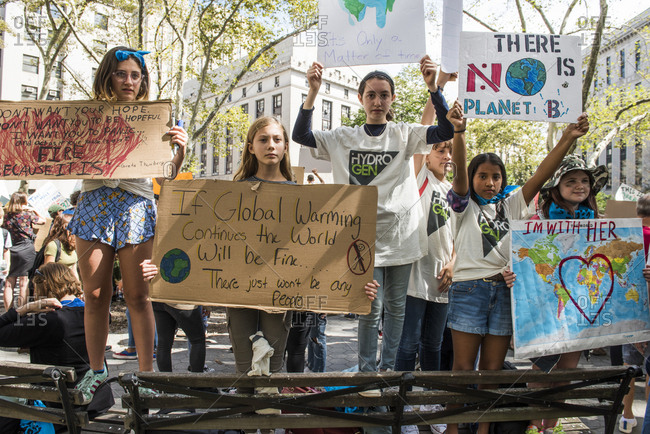 New York City, New York - September 20, 2019: Group of children holding signs at the Global Climate Strike