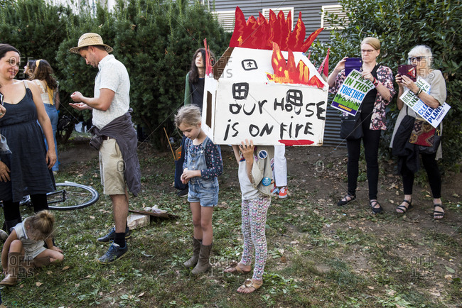 "New York City, New York - September 20, 2019: Kid wearing a cardboard house that says ""our house is on fire"" at the Global Climate Strike"