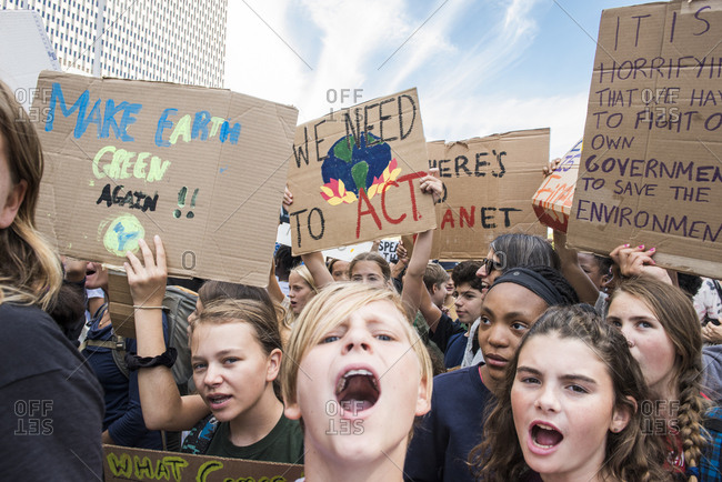 New York City, New York - September 20, 2019: Group of people chanting and holding signs at the Global Climate Strike
