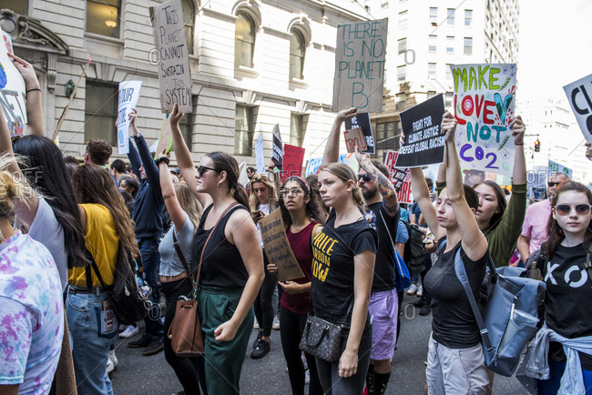 New York City, New York - September 20, 2019: Crowd marching with signs at the Global Climate Strike