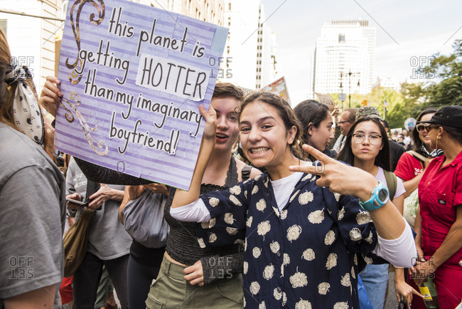New York City, New York - September 20, 2019: Young women marching with signs at the Global Climate Strike
