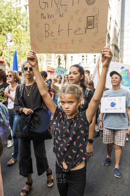 New York City, New York - September 20, 2019: Young girl holding sign while marching at the Global Climate Strike