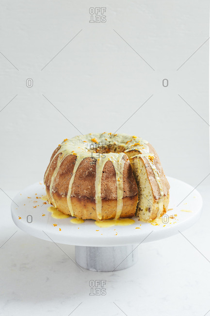 Delicious orange spice cake on marble cake stand