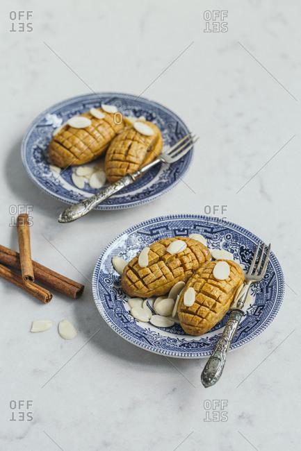 Cinnamon and almonds traditional Turkish dessert Kalburabasti served on two plates