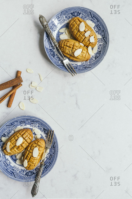 Overhead view of a cinnamon and almonds traditional Turkish dessert Kalburabasti