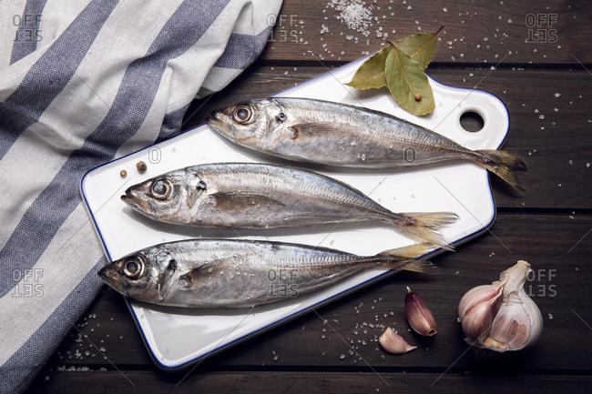 Fresh mackerel fish on cutting board ready to cook. raw seafood