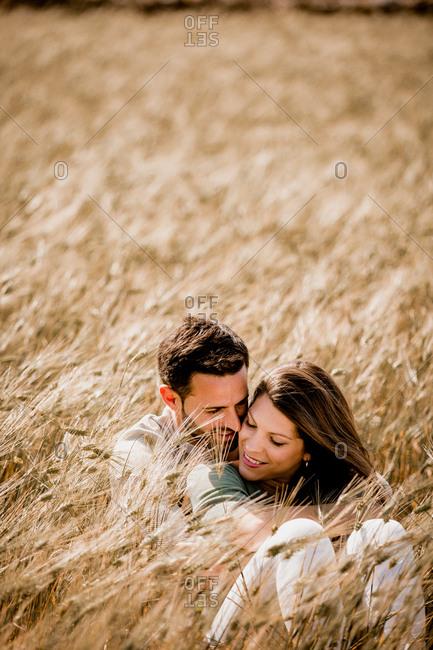Serene lovers embracing on wheat field