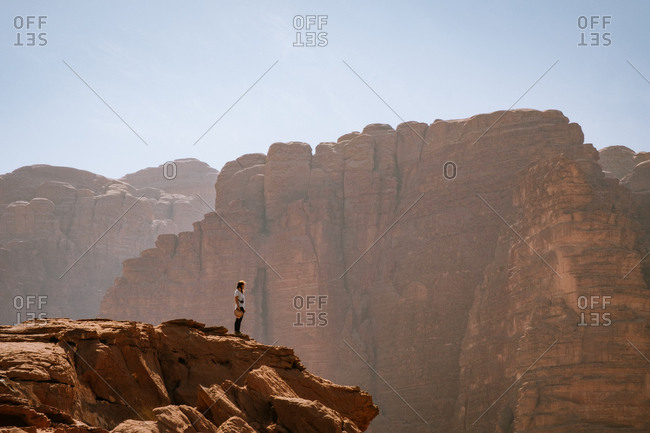 Woman on top of a rock in wadi rum