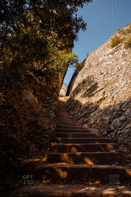 Bottom view of a road with stairs by the mountain of montserrat, catalonia, spain