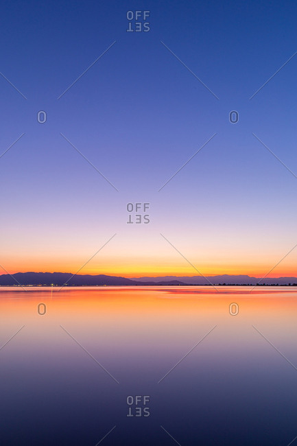 Intense colors of a sunset with reflections in the water