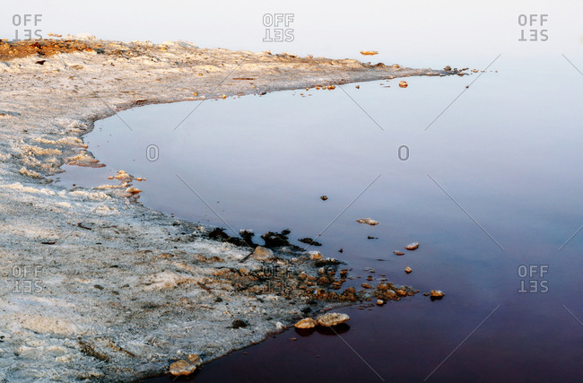 Beautiful lake with rocks in blue water