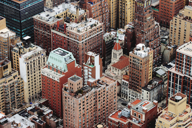 Aerial shot of brown and beige buildings in manhattan borough of new york city