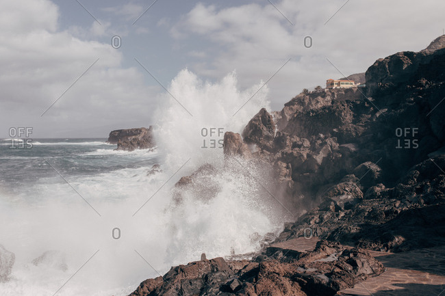 Ocean waves crashing into rocks on tenerife