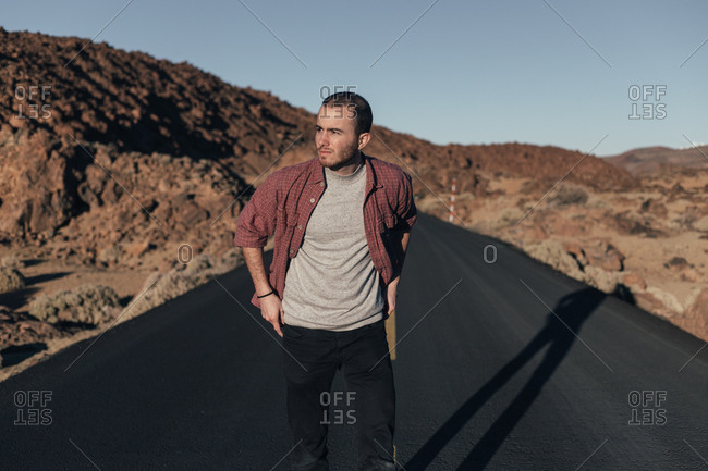 Man walking on mountain road on tenerife island