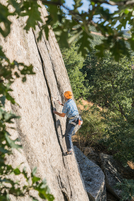Top view of free climber climbing in nature