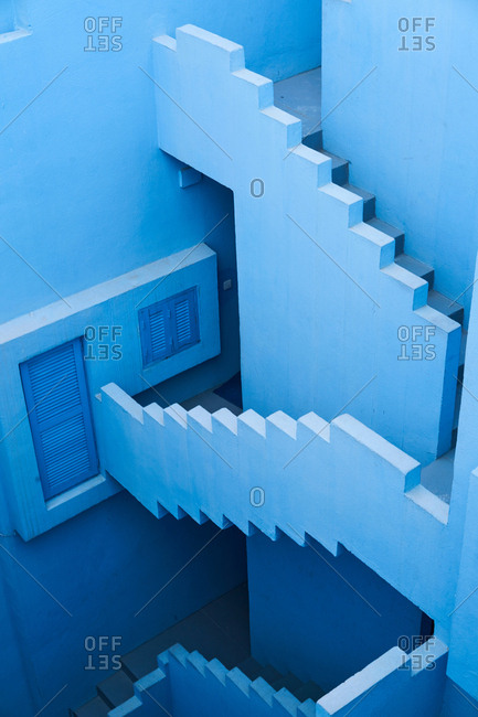 From above traditional construction stairs of bold blue color