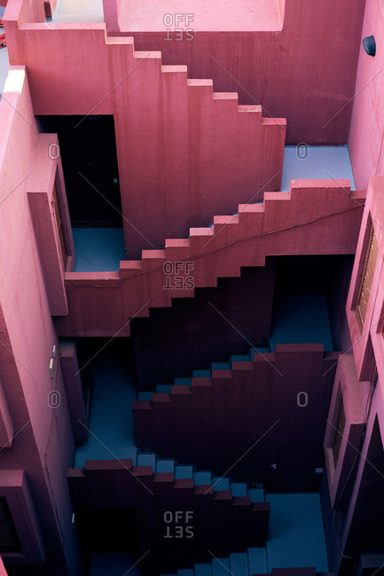 From above traditional construction of bold pink color with blue stairs