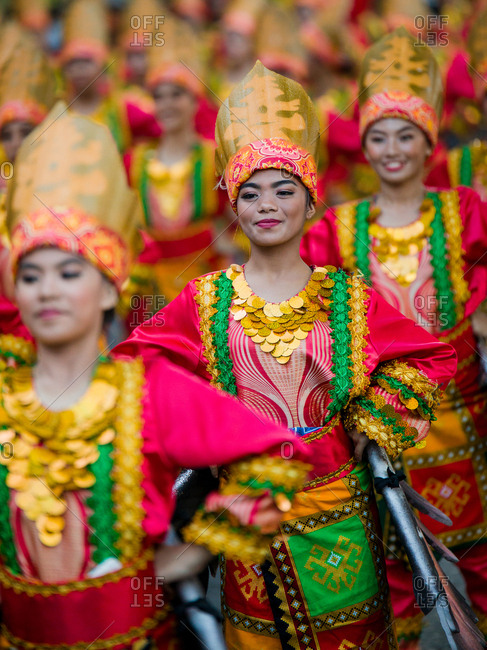 Davao, Philippines - November 13, 2018: Performers dressed in colorful costumes in the parade at the annual Kadayawan Festival