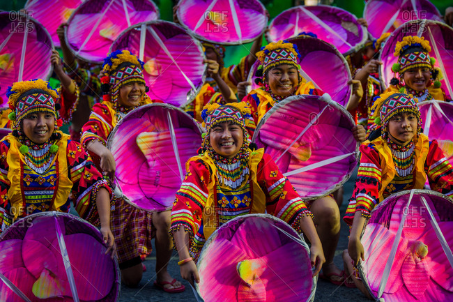 Davao, Philippines - November 13, 2018: Performers at the annual Kadayawan Festival holding bright pink props