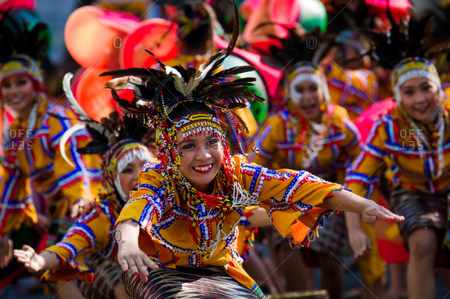 Davao, Philippines - November 13, 2018: Dancers wearing colorful costumes in the parade at the annual Kadayawan Festival