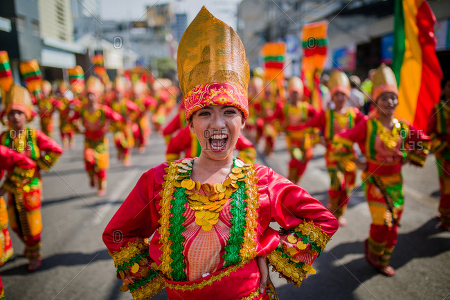 Davao, Philippines - November 13, 2018: Performers at the annual Kadayawan Festival walking in the parade wearing bright costumes
