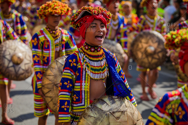Davao, Philippines - November 13, 2018: Young performers in the parade at the annual Kadayawan Festival wearing colorful costumes