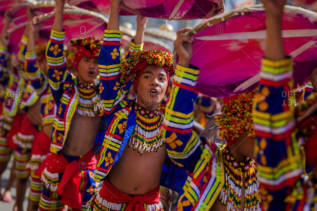 Davao, Philippines - November 13, 2018: Young male performers in the parade at the annual Kadayawan Festival wearing colorful costumes