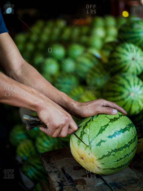 Watermelon being sliced in a market in the Philippines