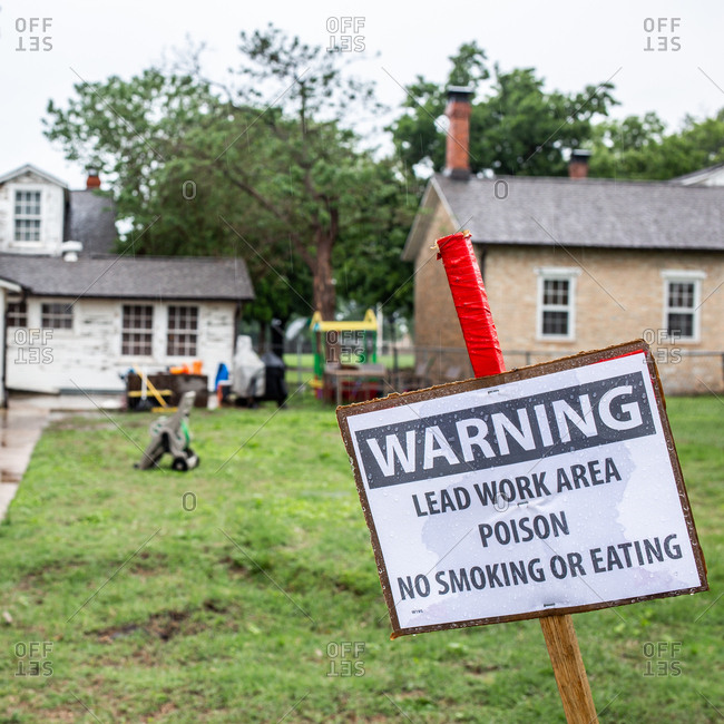 Warning sign for lead work being done on a house