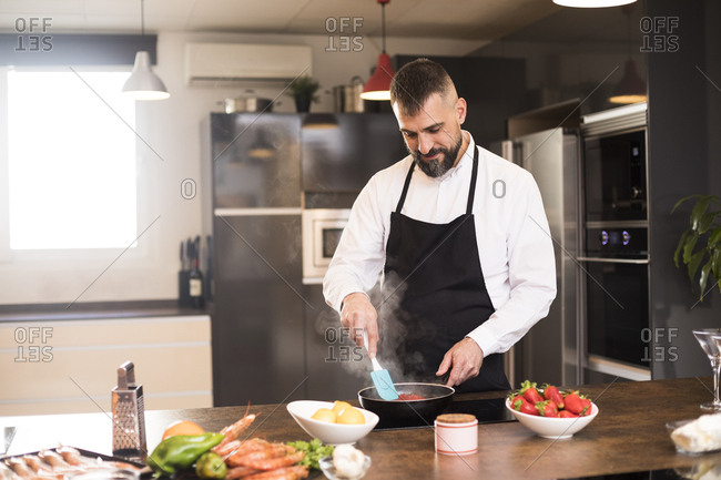 Confident chef with frying pan