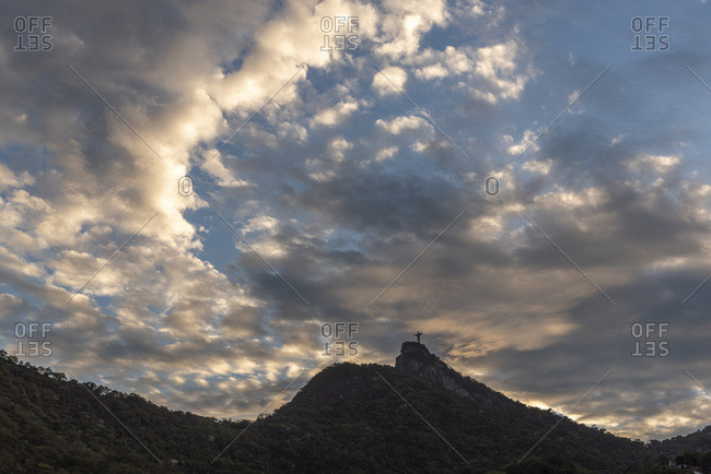 Christ the redeemer statue on corcovado mountain with beautiful clouds