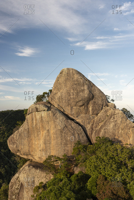 View to rocky mountain peak on beautiful sunset rainforest landscape