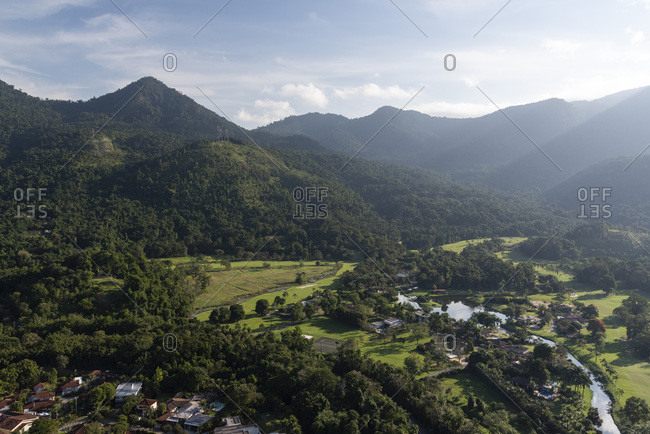 Aerial view from helicopter flight to green forest mountains