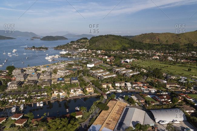 Aerial view from helicopter flight to wealthy ocean residential area
