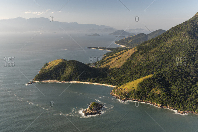 Aerial view from helicopter flight to beautiful beach and rainforest