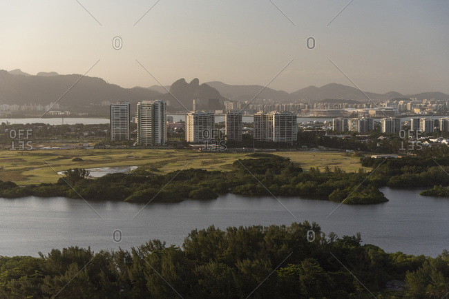 Aerial view from helicopter flight to city, lagoon and mountains